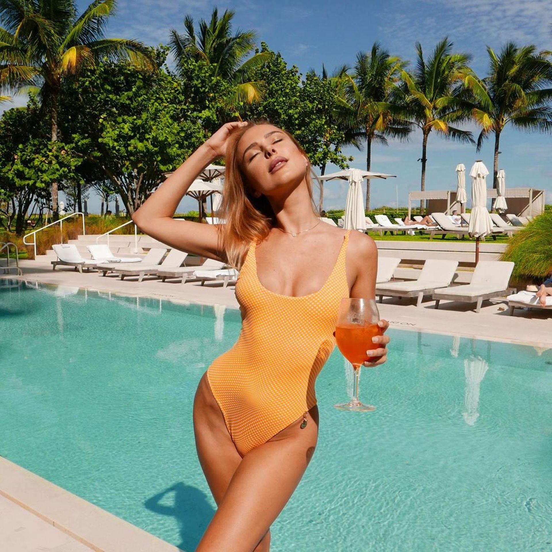 Kimberley Garner Seen Wearing An Orange Swimsuit In Miami 0001
