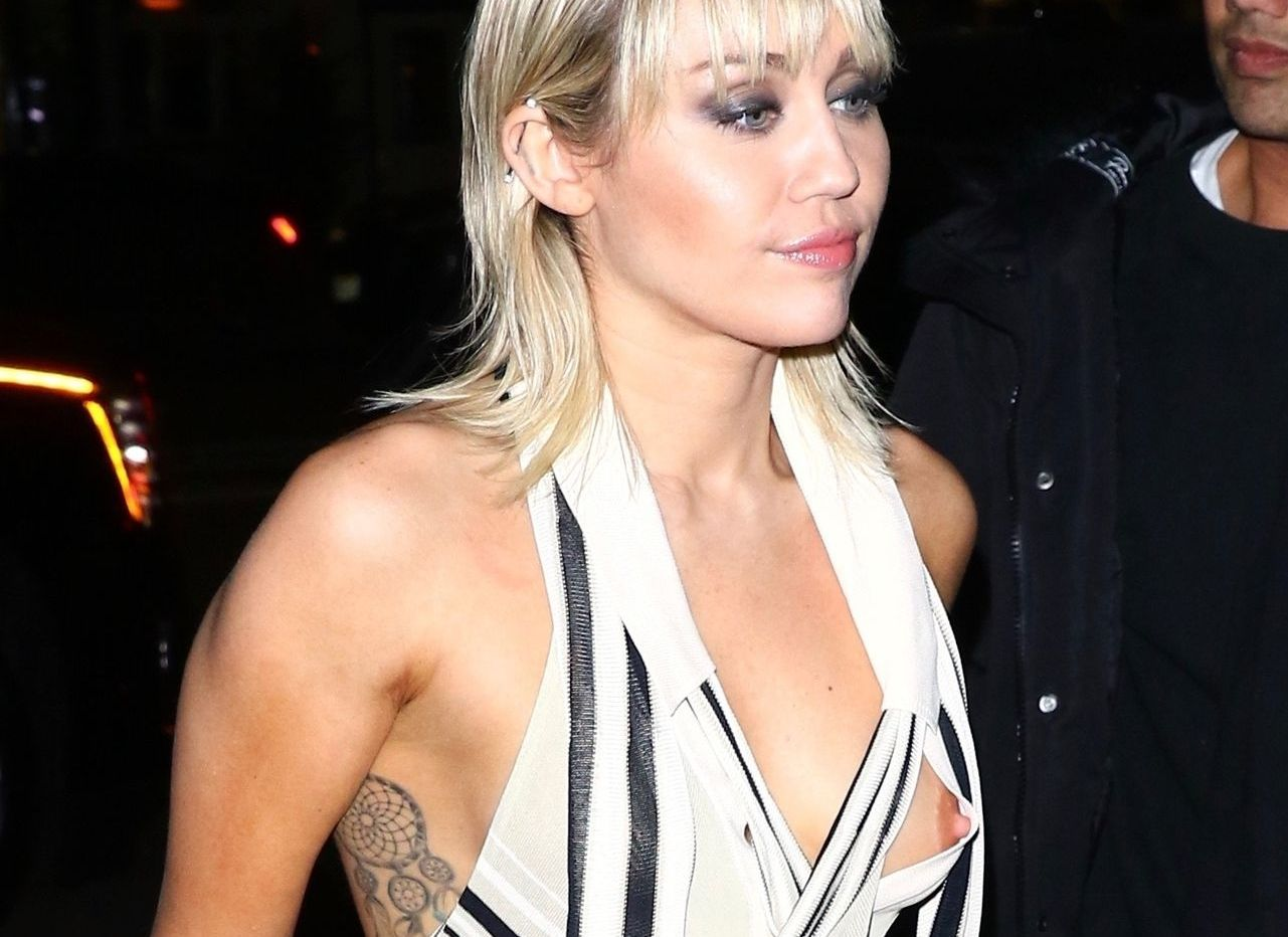 Miley Cyrus Has A Nip Slip In A Silk Top Arriving At The Bowery Hotel 0001