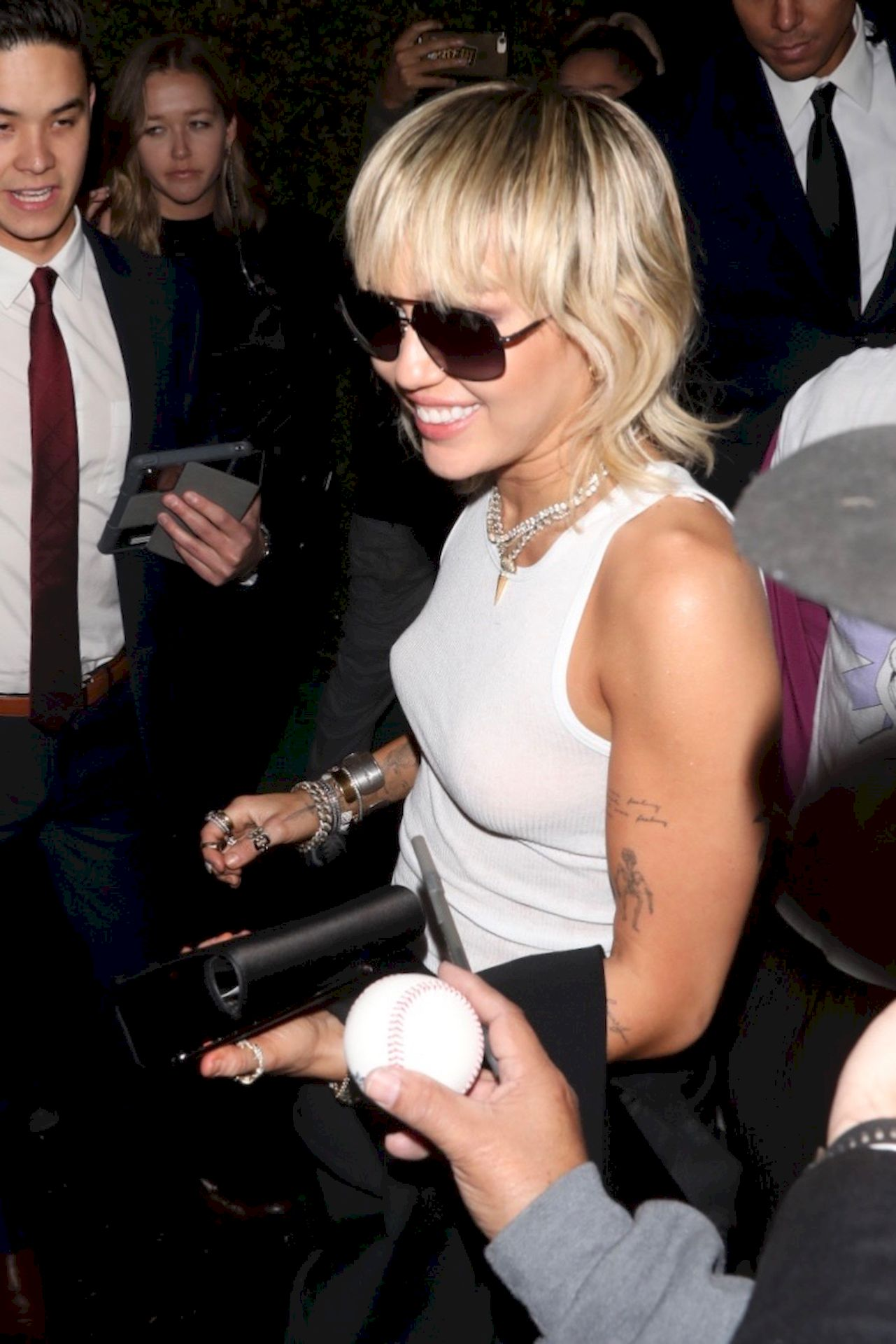Miley Cyrus Leaves Chateau Marmont Wearing A Plain White Tank Top 0005