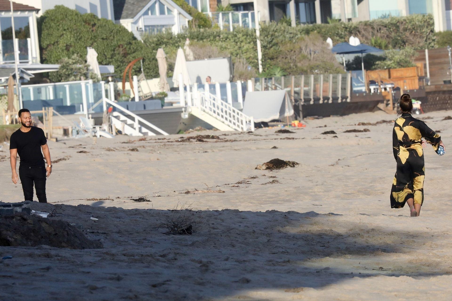 Chrissy Teigen Enjoys A Beach Day In Malibu Amid All Coronavirus Chaos 0025