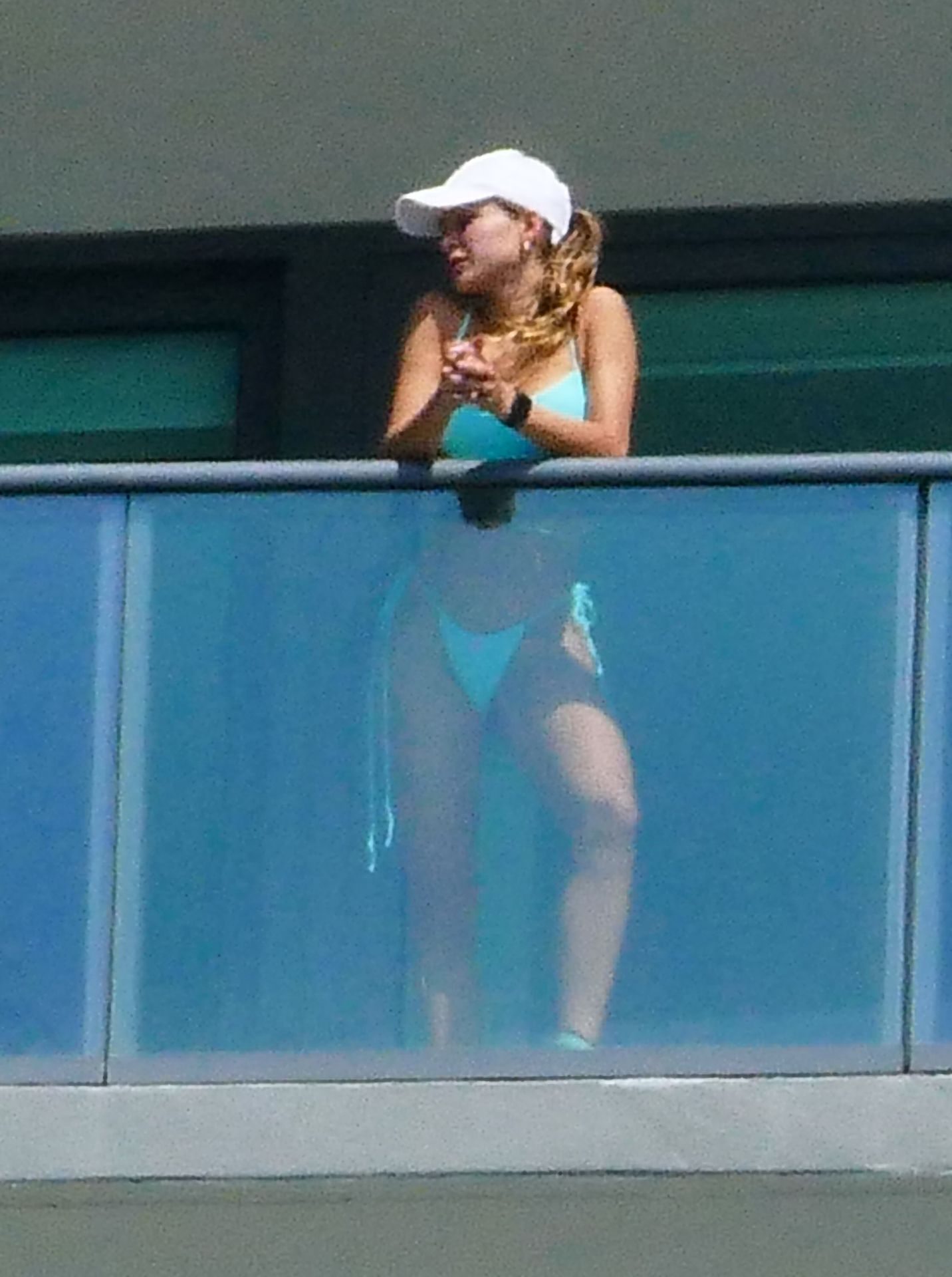 Cindy Prado Shows Off Her Curves In A Small Blue Bikini As She Works Out On A Balcony In Miami 0016