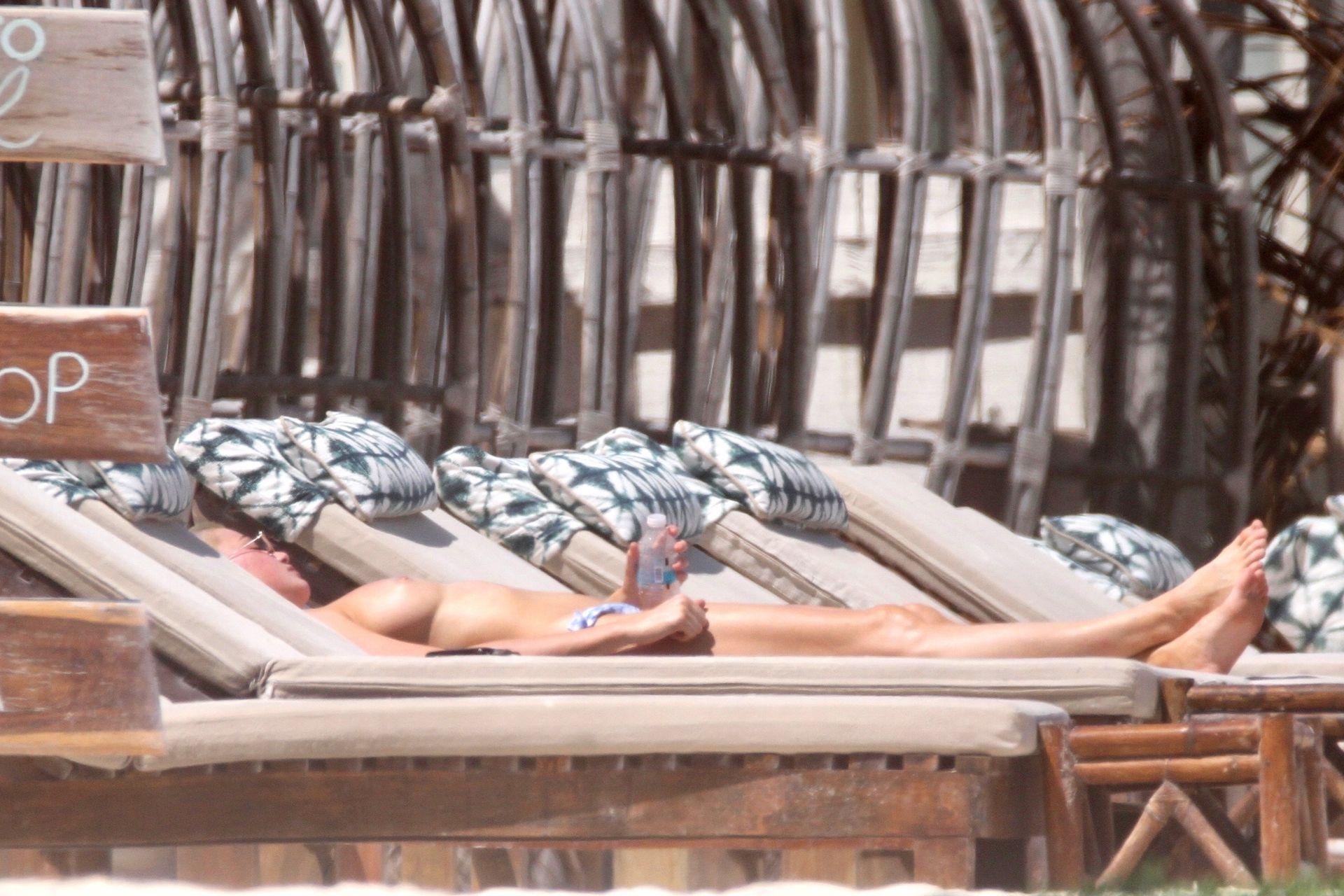Kristen Hancher Sunbathes Topless In Tulum 0001